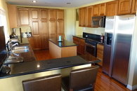 spacious kitchen, granite , bar
