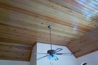 Wood ceiling and fan in each room