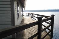 Large deck is over the water at high tide and spans the entire rear of the house.