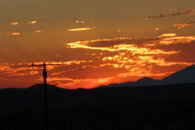 the setting sun over the mountains and JTNPP