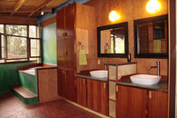 Forest Suite (Cal King bed & double futon sofa, deluxe bathroom, kitchen, dining room): $350/day. Cleaning fee $100. 7 days or more $300