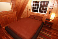 Queen size bed with ergonomic mattress at the pine bedroom upstairs