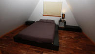 Queen size bed with natural latex mattress at the white bedroom upstairs
