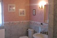 The Romantica's bathroom with tube and shower