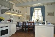 The fascinating kitchen  have direct access to the outside via the French doors