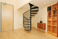 Spiral staircase leads you to the upstairs bedroom