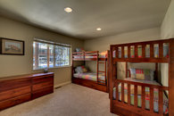 Bunk room with 2 bunk beds and a trundle