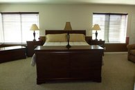 Master Bedroom Suite with fireplace, tv, and lounge.