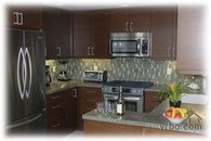 Kitchen - granite counters, custom cabinets