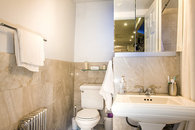 Bathroom has a marble floor and walls