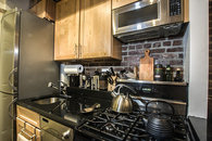 Black granite counter top in the kitchen - cook at home