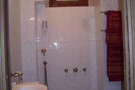 Bathroom with shower without playpen.