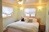 one of three of the bedrooms, all with king or twin beds