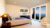 Master bedroom with lake views and a 10 foot double head rock shower
