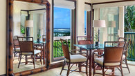 Dining area with ocean view and standing mirror