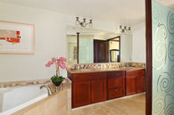 Master bathroom is very spacious with a huge corner bath tub and Fine Art on the walls