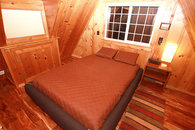 Knotty pine bedroom upstairs with queen size mattress