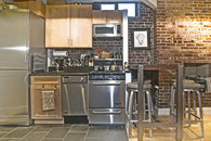 Stainless steel appliances, dishwasher and bar table