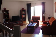 Spacious livingroom with LCD tv, DVD player, books, cd's, dvd's, games
