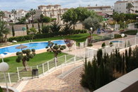 Big communal swimmingpool with jacuzzi, garden to sunbathe and a playground for the children