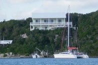 Cliff House and Boats seen from Sea of Abaco