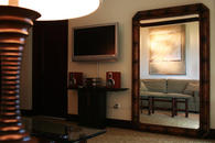 Living room interior with stand up mirror, Fine Art and Flat Screen Sony Bravia TV and DVD/Stereo System