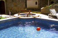Relax in the pool and jacuzzi in reliable summer sunshine