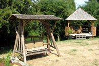Swinging Chair and Gazebo for Eating, Relaxing and Enjoying the wonderful garden