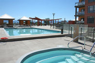 Swimming Pool and Hot Tub at Playa Del Sol. View of Lake Okanagan