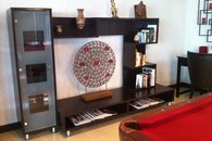 Living room wall unit with art and books