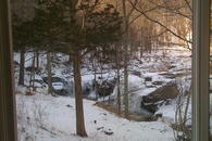 Winter view of waterfalls from living room at The Waterfall House a vacation home rental near Woodstock NY