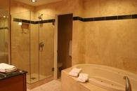 Master bathroom with separate shower and jacuzzi bath tub